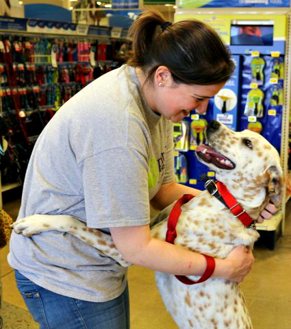 Jude, who is waiting at In the Arms of Angels, hugs his foster mom, Jen.